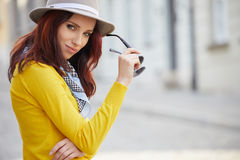 Fashionably dressed woman on the streets royalty free stock photos