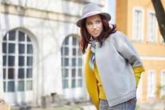 Fashionably dressed woman on the streets royalty free stock photo