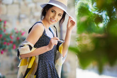 Fashionably dressed woman on the streets of a small Italian town.  Royalty Free Stock Photography