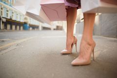 Fashionably dressed woman on the streets of a small town, shopping concept royalty free stock photography