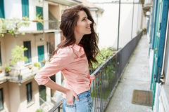 Fashionably woman on the house of a Italian town Royalty Free Stock Images