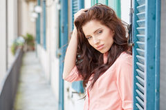 Fashionably woman on the house of a Italian town Royalty Free Stock Photography