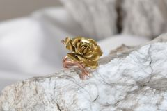 Fashioned cooper-brass ring on the stone in the form of a flower stock photo