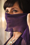 Fashioned woman with face covered Stock Photography
