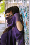 Woman with face covered in Turkish palace. Stock Image