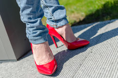 Fashioned woman wearing red high heel shoes Stock Images