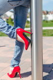 Fashioned woman wearing red high heel shoes Stock Photography