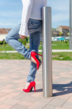 Fashioned woman wearing red high heel shoes Stock Photo