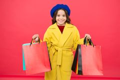 Fashionista adore shopping. Obsessed with shopping. Get major wardrobe refresh with spring sales at stores. Girl cute. Kid hold shopping bags red background royalty free stock photos