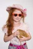 Fashionista d'une chevelure rouge six ans Photo stock