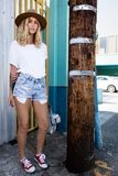 Fashionista girl standing in the backstreet. Fashionista girl standing in the backstreet of Los Angeles royalty free stock photos