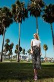 Fashionista girl standing on the broadwalk. Fashionista girl standing on the broadwalk of Venice stock photos