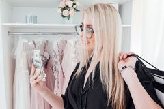 Fashionista lifestyle woman evening gown boutique. Fashionista lifestyle. Luxury boutique. Gorgeous woman holding money and packages royalty free stock photo