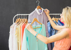 Fashionista looking at two dresses Stock Image