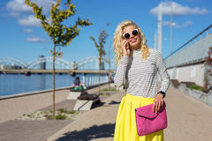 Fashionista talking on the phone. In the city stock photo