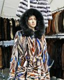 Fashionnable hooded fur coat on mannequin Stock Photography