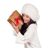 Fashionwoman portrait hold christmas gift. Royalty Free Stock Image