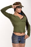 Fasion model military salute. Model in a military hat saluting Stock Photos