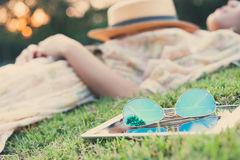 Fasion sun glasses with young woman sleeping in background, vint Royalty Free Stock Photos