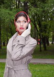 Fasionable asian  business woman. Call a phone Royalty Free Stock Photo