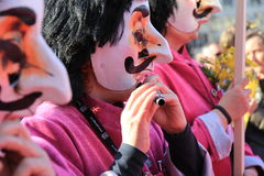 Fasnacht Festival, Basel. Basel Fasnacht festival, People play flute with Waggis Mask stock photos