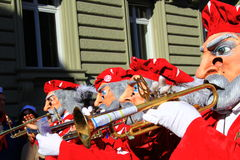 2015 Fasnacht Festival, Basel. Fasnacht Festival in Basel, People play with Waggis Mask. It is from 23 to 25 of February. This is the people play trumpet royalty free stock images