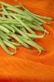 fasola zielone pomarańcze surowej Zdjęcie Stock
