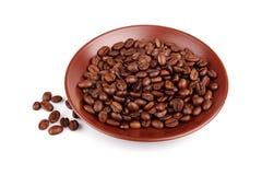 fasoli coffe rozsypisko odizolowywający piec spodeczek Zdjęcia Stock