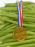 Fasolki szparagowe z złotym medalem Obrazy Stock