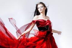 Fasonuje fotografię młoda wspaniała kobieta w czerwieni Obraz Royalty Free