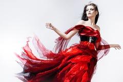 Fasonuje fotografię młoda wspaniała kobieta w czerwieni Fotografia Stock