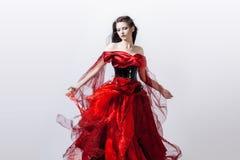 Fasonuje fotografię młoda wspaniała kobieta w czerwieni Obrazy Royalty Free