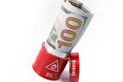 Fassöl mit Dollar Stockbilder