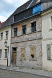 Fassade of an old, damaged  House. Fassade of an old, damaged house with broken windows, close up Royalty Free Stock Image