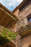 Fassade rural house balcony Mura, Spain. Traditional fassade of a catalan rural house at the medieval town of Mura in northeastern Spain Royalty Free Stock Photography