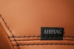 Fassen Sie ` Airbag ` ab, das auf Auto ` s Sitz geschrieben wird Stockbilder