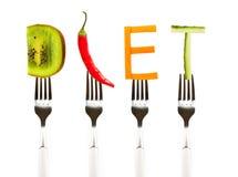 Fassen Sie die Diät ab, die vom frischen geschmackvollen Gemüse auf Gabeln gemacht wird stockfoto