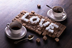 Fassen Sie die Liebe ab, die vom Zucker und von den leeren Schalen gemacht wird Lizenzfreies Stockfoto