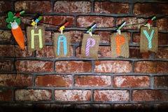 Fassen Sie glückliches auf den Sackleinentags ab, die an einer Linie hängen Lizenzfreies Stockbild
