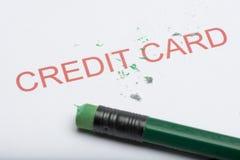 Fassen Sie ` Kreditkarte ` mit abgenutztem Bleistift-Radiergummi und Schnitzeln ab Lizenzfreies Stockfoto