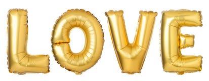 fassen Sie LIEBE im englischen Alphabet von den goldenen Ballonen ab Stockfotografie