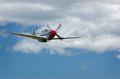 Fast!. P-51 Mustang fighter aircraft below clouds stock photography