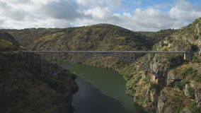 Fast aerial view of iron bridge over canyon in Zamora, Spain stock video