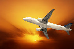 Fast airplane. With red sunset Stock Photos