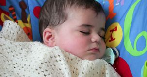 Fast Asleep in the Baby Bouncer stock footage