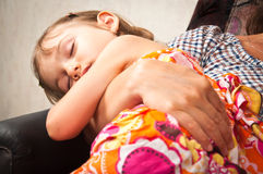 Fast asleep in mother's hands Stock Photos