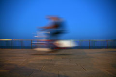 Fast bicycle rider. Running fast, blured aspect Stock Photos