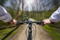 Fast Bike Ride through the woods stock photo