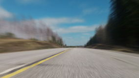 Fast blurred driving over the highway Stock Image