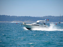Fast boat. On wavy  blue sea Royalty Free Stock Image